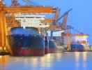 panorama scene of ship yard with heavy crane in beautiful twilight
